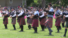 Scottish marching pipe bands and bagpipes  performing at highland games Stock Footage