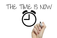 Hand writing the time is now Stock Illustration