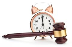 Gavel and old clock Stock Photos