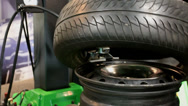 Stock Video Footage of Tire tyre being mounted on a wheel