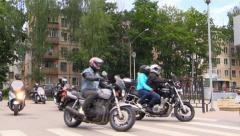 Group of bikers arrive the town Stock Footage