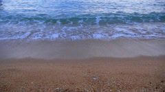 Sandy Beach and Foamy Sea Waves. Close up. Stock Footage