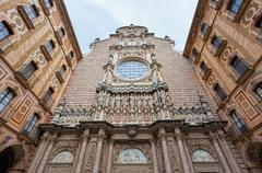 facade of the basilica at the benedictine abbey at montserrat, santa maria de - stock photo