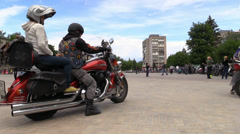 Group of bikers ride town square Stock Footage