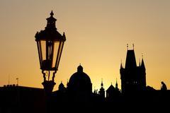 ancient lamp in prague against sunrise - stock photo