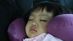 Asian child sleeping in a car Stock Footage
