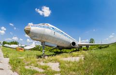 old russian aircraft tu-104 at an abandoned aerodrome - stock photo