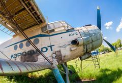 Old russian aircraft an-2 at an abandoned aerodrome Stock Photos