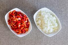 Prepared diced fresh onions and tomato Stock Photos