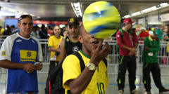 Brazilian fan plays with his ball Stock Footage