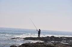 fisherman at laguna beach - stock photo