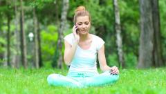 Yoga after a telephone conversation. Stock Footage