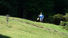 Playing frisbee golf Stock Footage