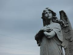angel ahead of the storm - stock photo