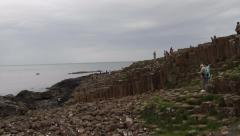 Tourists at Giants Causeway, Bushmills, Northern Ireland Stock Footage