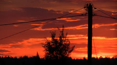 Electric pole with wires on sunset background Stock Footage