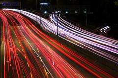 Night highway (Cars in a rush moving fast on a highway (speedway) - stock photo
