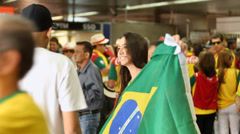 Brazilian fan shows the flag before the match of Brazil Stock Footage