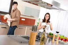 Happy couple cook in modern kitchen Stock Photos