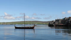 Replica viking longship and Lerwick waterfront Shetland, Scotland - stock footage