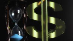 Hourglass on background dollar symbol Stock Footage