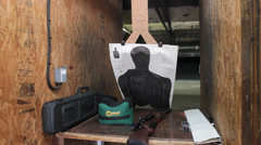 Rifle and Target Ready at an Indoor Gun Range Stock Footage