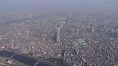 Aerial zoom Tokyo Skytree observation Tower Sumida River Japan - stock footage