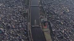 Aerial Metropolis Sumida River bridges shipping Tokyo district Japan Stock Footage
