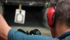 Elderly Man Sends Shooting Target Out to Proper Distance Stock Footage