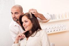 Professional hairdresser choose hair dye color at salon Stock Photos
