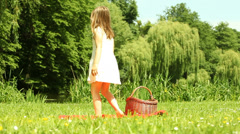 Little girl child kid dancing on the meadow - stock footage