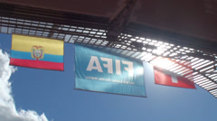 Switzerland, Ecuador and Fifa's flag inside the National Stadium in World Cup Stock Footage