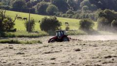 Red Tractor moves through picturesque rural European Landscape Stock Footage