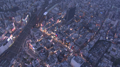 Aerial illuminated Shinjuku buildings lights Rail Track Tokyo Japan - stock footage