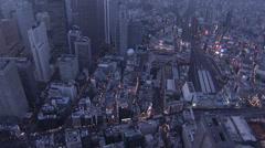 Aerial illuminated Shinjuku Cocoon skyscraper Rail Station Tokyo Japan Stock Footage