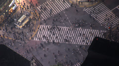 Aerial illuminated Shibuya road crossing people transport intersection Tokyo Stock Footage