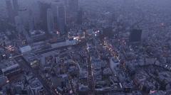 Aerial illuminated Shinjuku Skyscrapers Financial District National Rail Japan Stock Footage