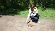 Stock Video Footage of Mother and baby feeding squirrel in the park