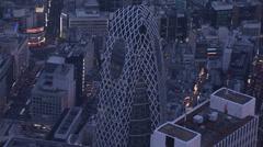 Aerial close up Mode Gakuen Cocoon Tower illuminated Shinjuku city Tokyo - stock footage