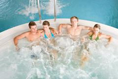 Top view - people relax in hot tub - stock photo