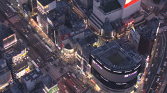 Aerial illuminated Tokyo Shinjuku buildings people traffic Japanese Rail Stock Footage