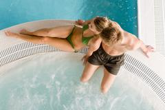 Top view - young couple relax in swimming pool - stock photo