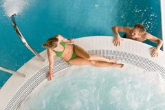 Top view - young couple relax in swimming pool Stock Photos