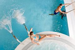 Top view - couple relax in swimming pool - stock photo