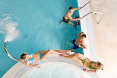 Top view - young people relax in swimming pool Stock Photos