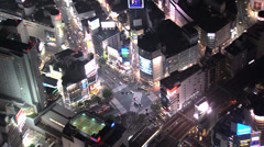 Aerial illuminated Shibuya scramble crossing people vehicles Tokyo Stock Footage