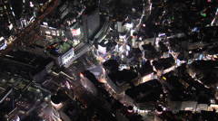 Aerial illuminated Shibuya road crossing night people intersection Tokyo Stock Footage