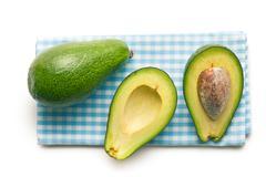 halved avocados - stock photo