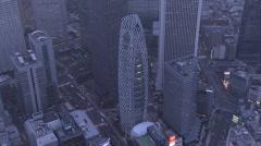 Aerial close up Mode Gakuen Cocoon Tower illuminated Shinjuku city Tokyo Stock Footage