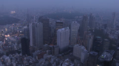Aerial illuminated Shinjuku Skyscrapers neon Financial District Rail Japan Stock Footage